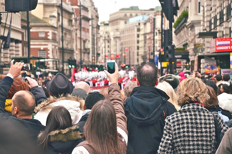 Crowd watching a parade. Photo by Yolanda Sun on Unsplash